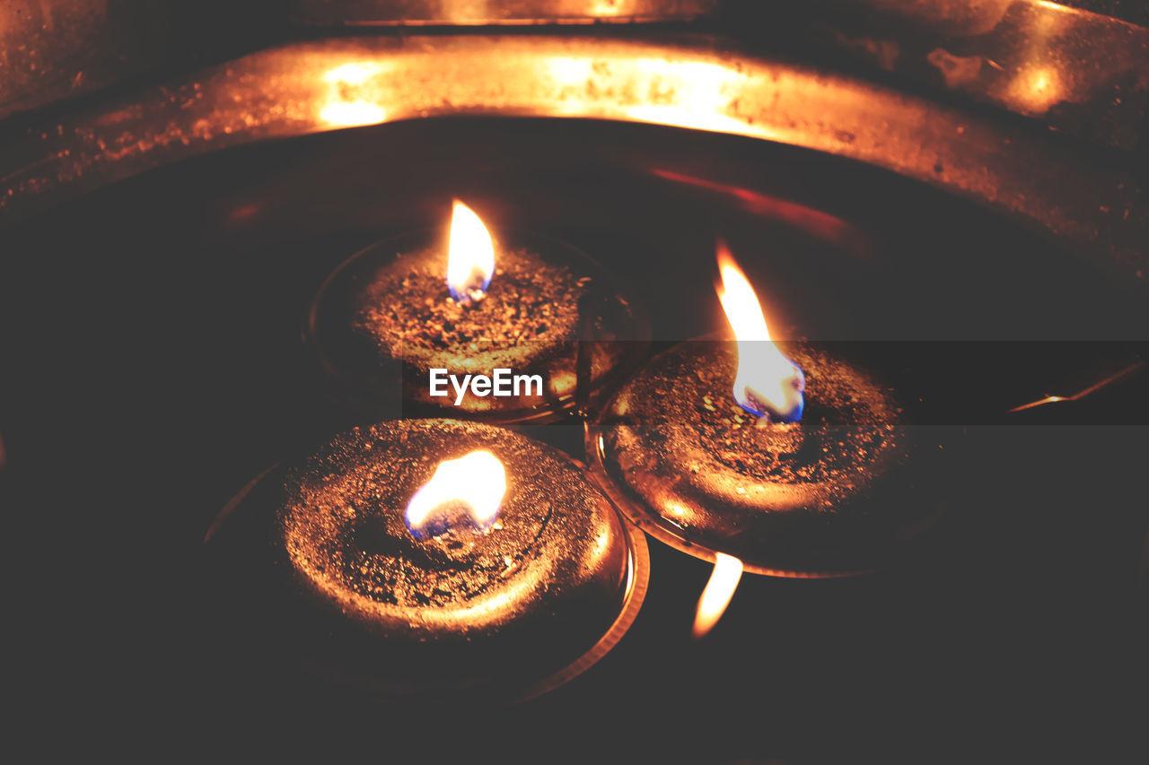 flame, burning, heat - temperature, fire, illuminated, fire - natural phenomenon, glowing, close-up, lighting equipment, nature, no people, oil lamp, indoors, candle, electric lamp, diya - oil lamp, dark, diwali, celebration
