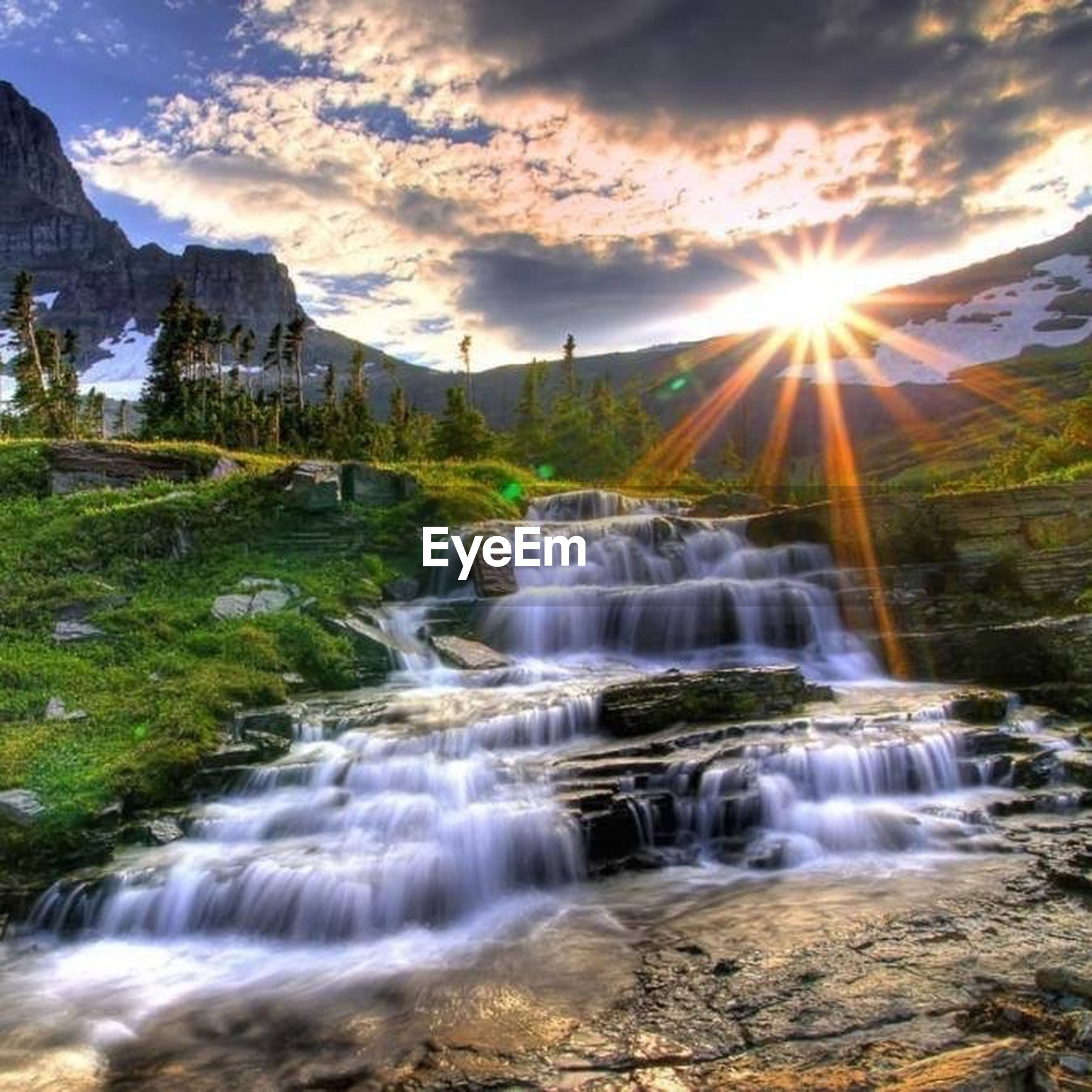 water, flowing water, motion, waterfall, scenics, beauty in nature, long exposure, sky, flowing, nature, sunbeam, rock - object, tranquil scene, river, mountain, stream, sunlight, idyllic, sun, cloud - sky