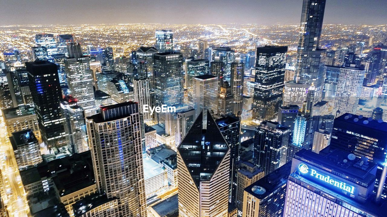 skyscraper, city, cityscape, architecture, modern, illuminated, building exterior, tower, tall, travel destinations, skyline, development, no people, night, financial district, aerial view, downtown, downtown district, built structure, urban skyline, outdoors, growth, office park
