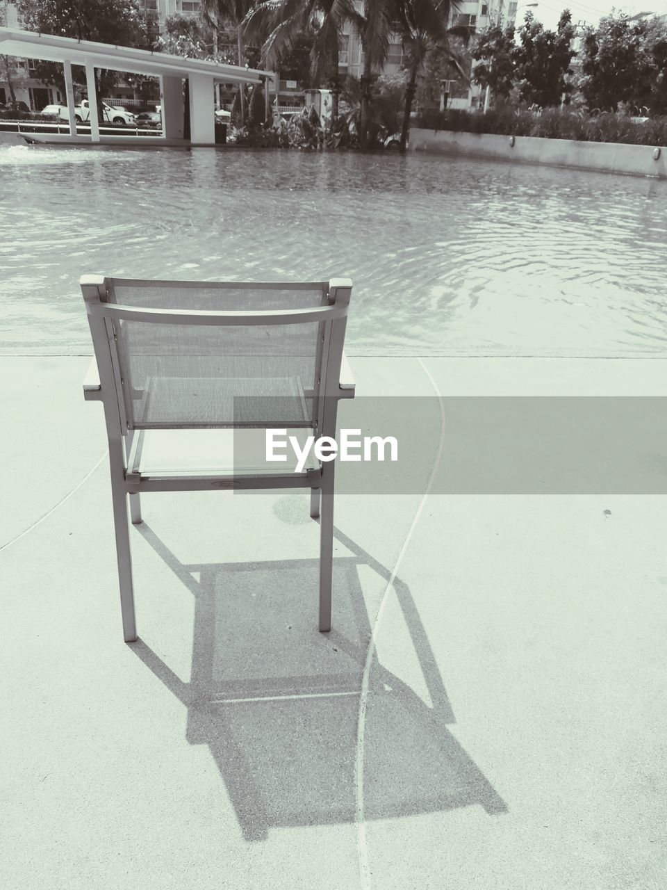 absence, no people, chair, water, day, outdoors, swimming pool, architecture, tree