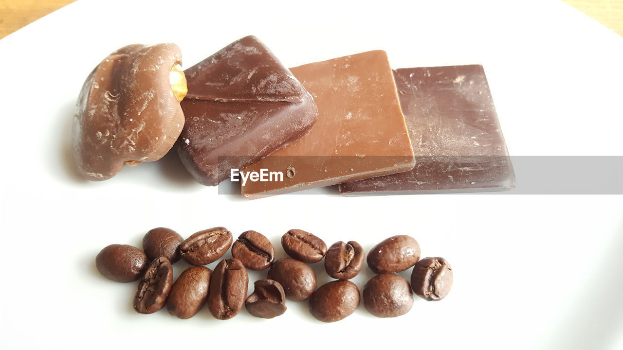 food and drink, still life, food, brown, freshness, close-up, no people, white background, high angle view, studio shot, dark chocolate, coffee bean, sweet food, raw coffee bean, indoors, ready-to-eat