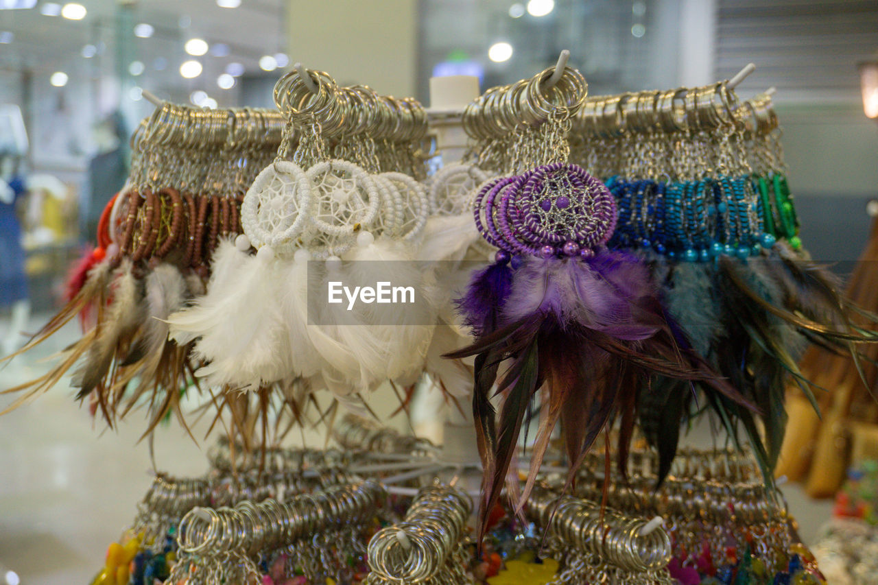 focus on foreground, indoors, close-up, no people, still life, art and craft, choice, creativity, retail, craft, variation, for sale, representation, selective focus, human representation, clothing, costume, celebration, textile, retail display, personal accessory