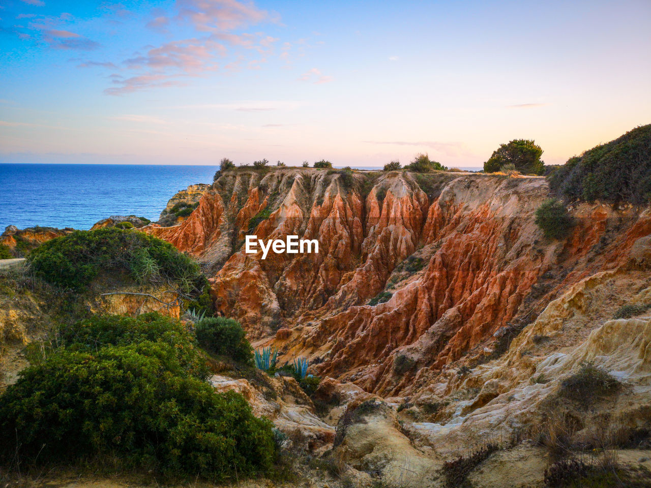 sky, scenics - nature, beauty in nature, sea, water, tranquil scene, horizon, tranquility, nature, land, rock, non-urban scene, no people, horizon over water, environment, plant, sunset, beach, rock - object, outdoors, eroded