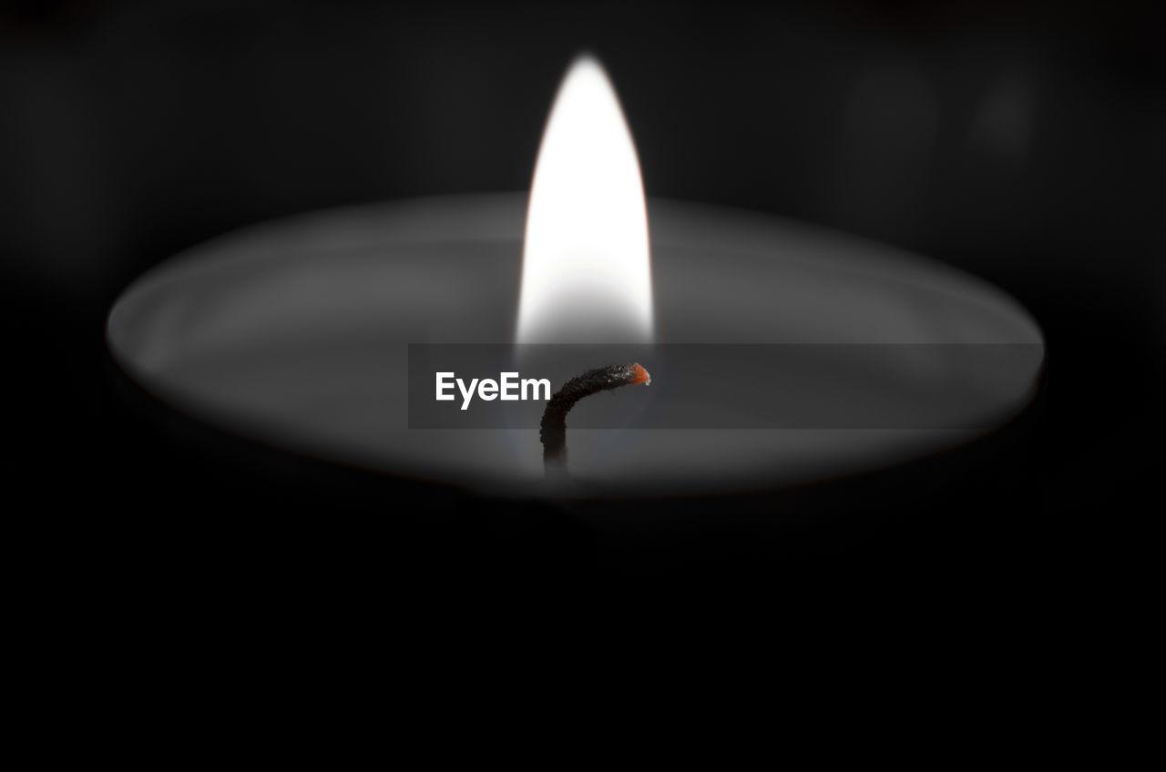 flame, burning, heat - temperature, candle, black background, glowing, no people, close-up, night, darkroom, studio shot, indoors, illuminated, diya - oil lamp, diwali