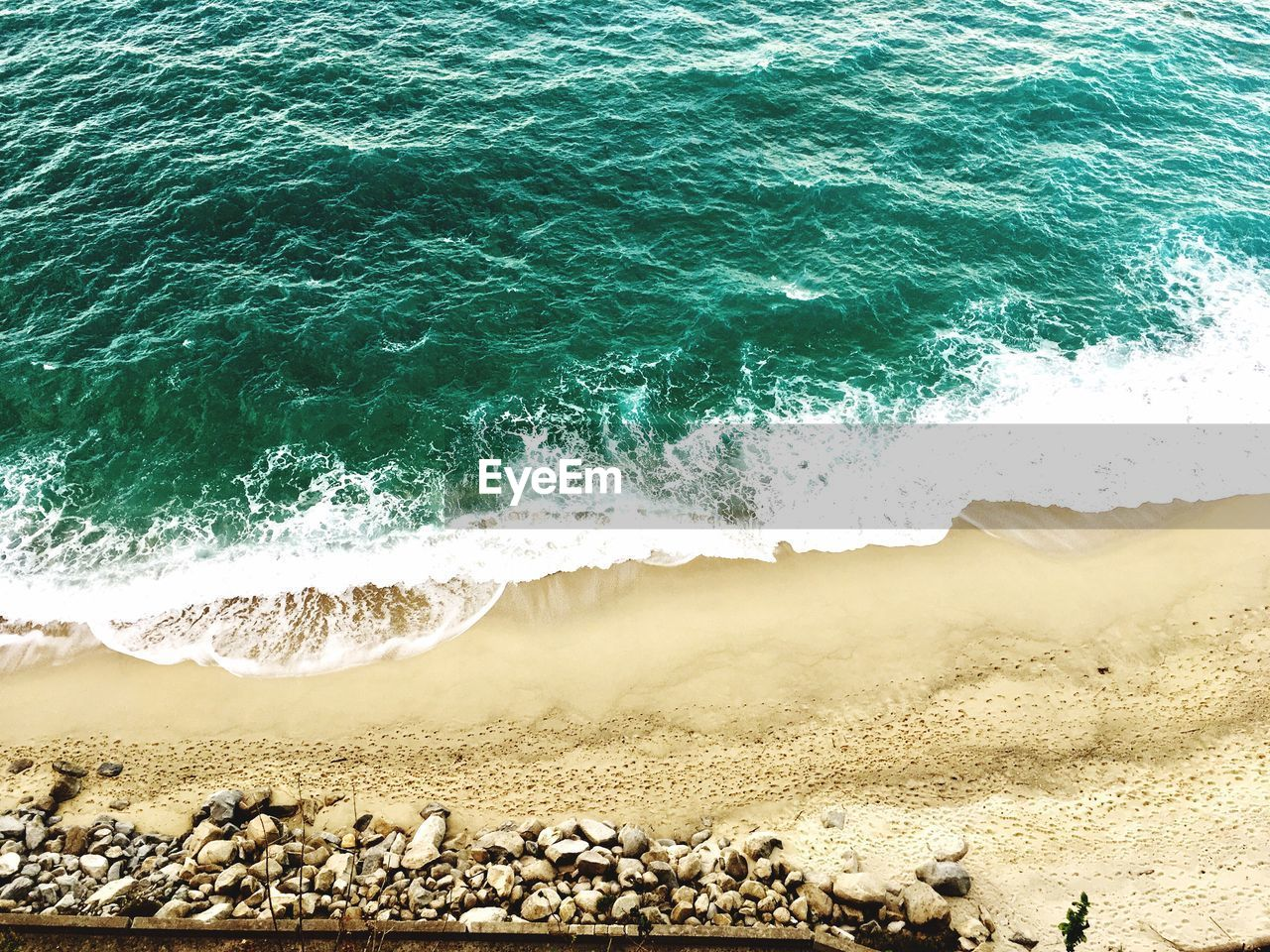 sea, beach, wave, water, land, beauty in nature, motion, nature, day, sport, aquatic sport, no people, sand, rock, solid, scenics - nature, high angle view, outdoors, power in nature, breaking