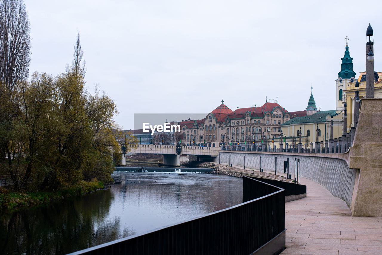 VIEW OF BUILDINGS BY RIVER