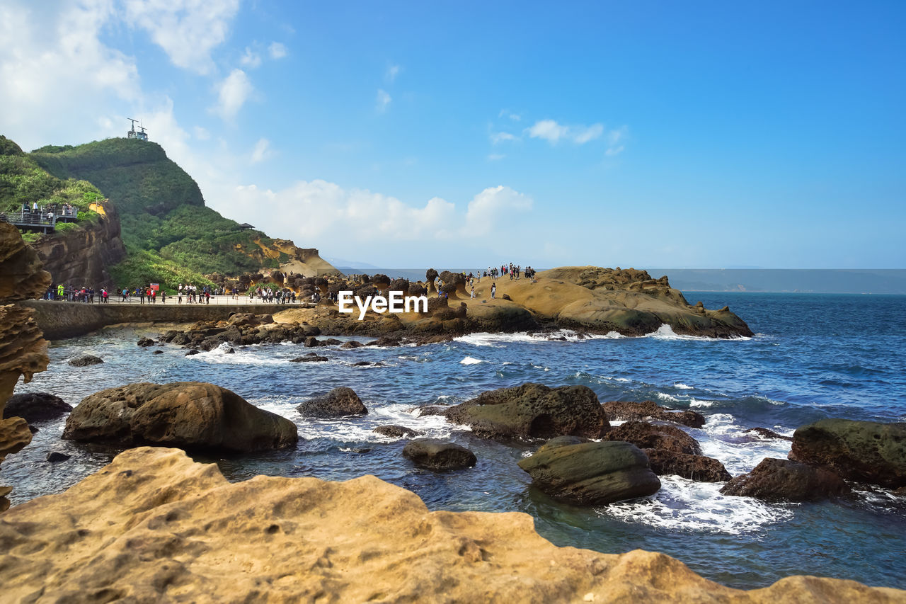water, rock, sky, sea, rock - object, beauty in nature, scenics - nature, solid, land, beach, nature, rock formation, cloud - sky, day, tranquility, tranquil scene, mountain, no people, non-urban scene, outdoors, rocky coastline