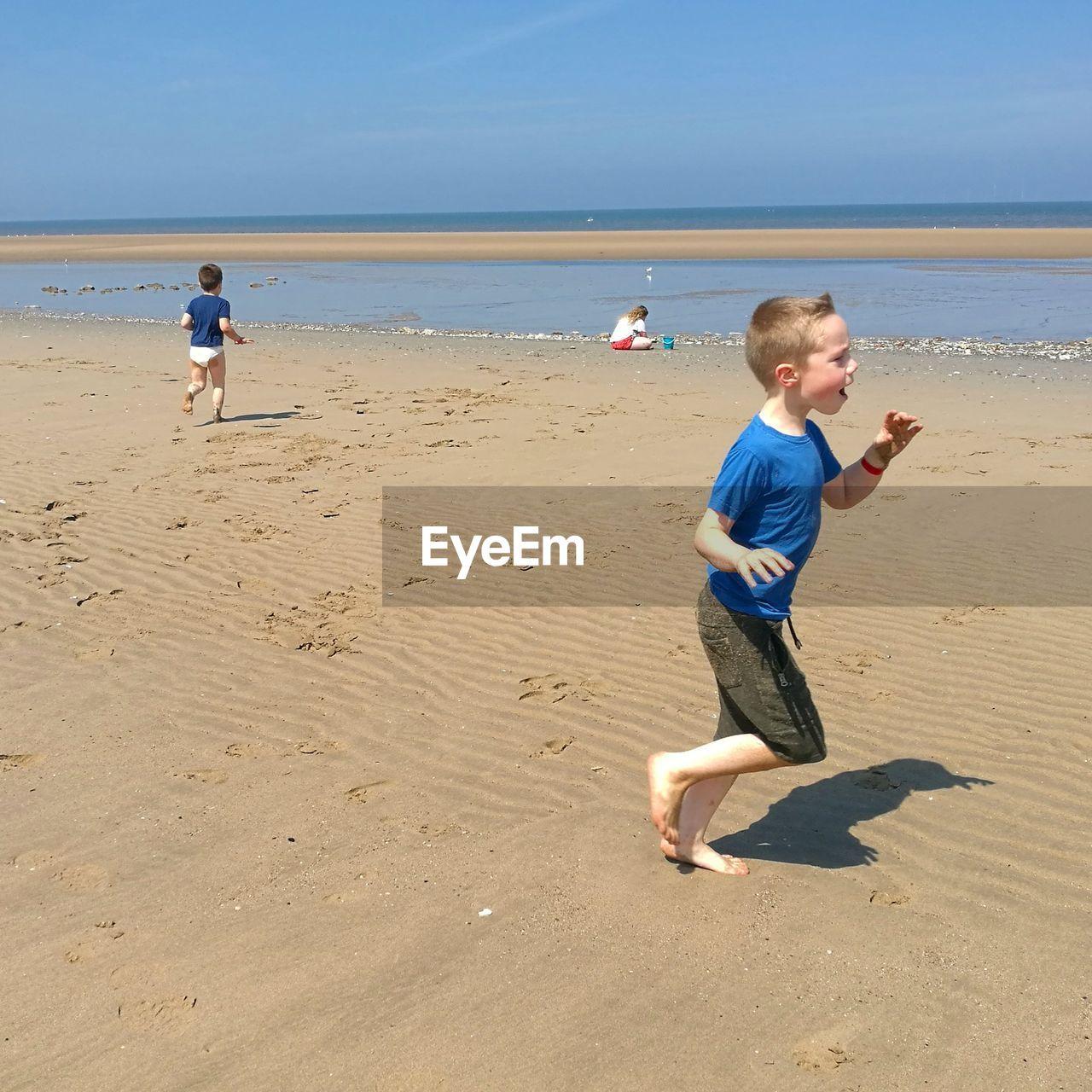 Full length of children on shore at beach