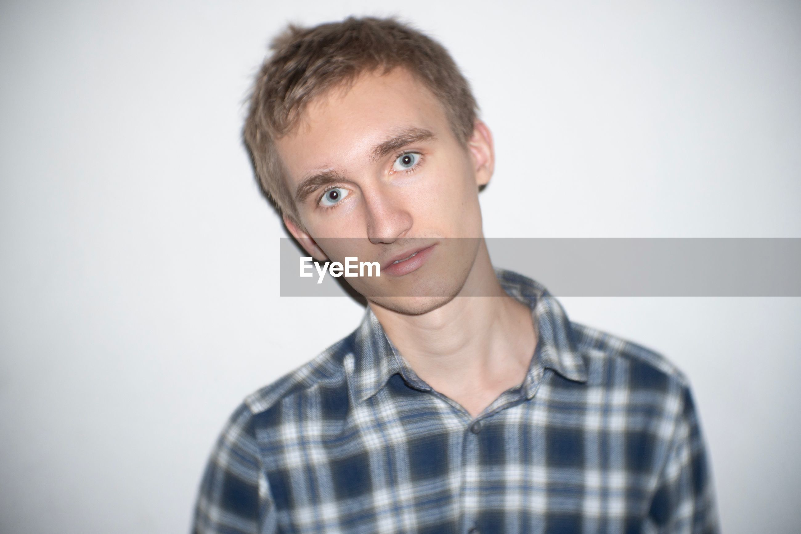 Portrait of young man against white background