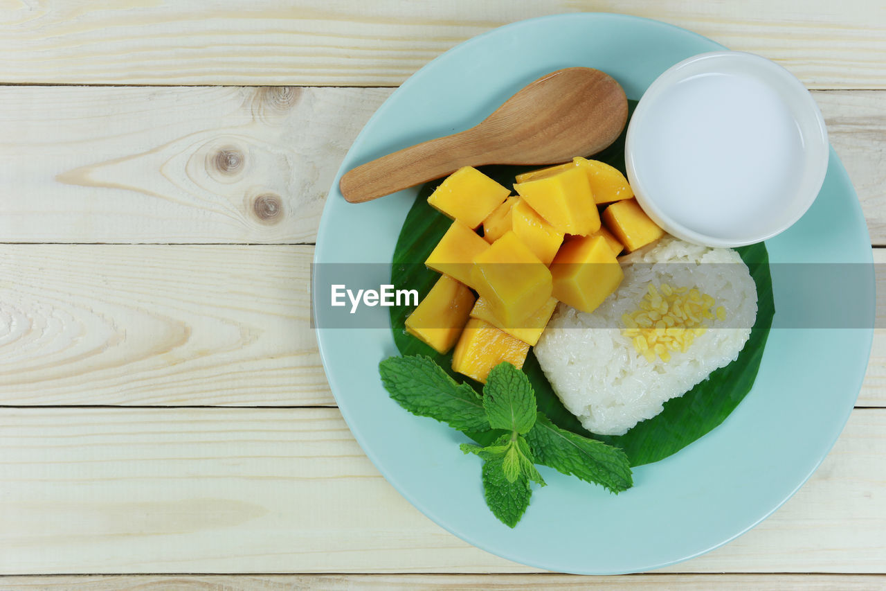 food, food and drink, table, freshness, healthy eating, wood - material, high angle view, wellbeing, directly above, still life, no people, indoors, plate, ready-to-eat, bowl, vegetable, fruit, slice, serving size, close-up, chopped