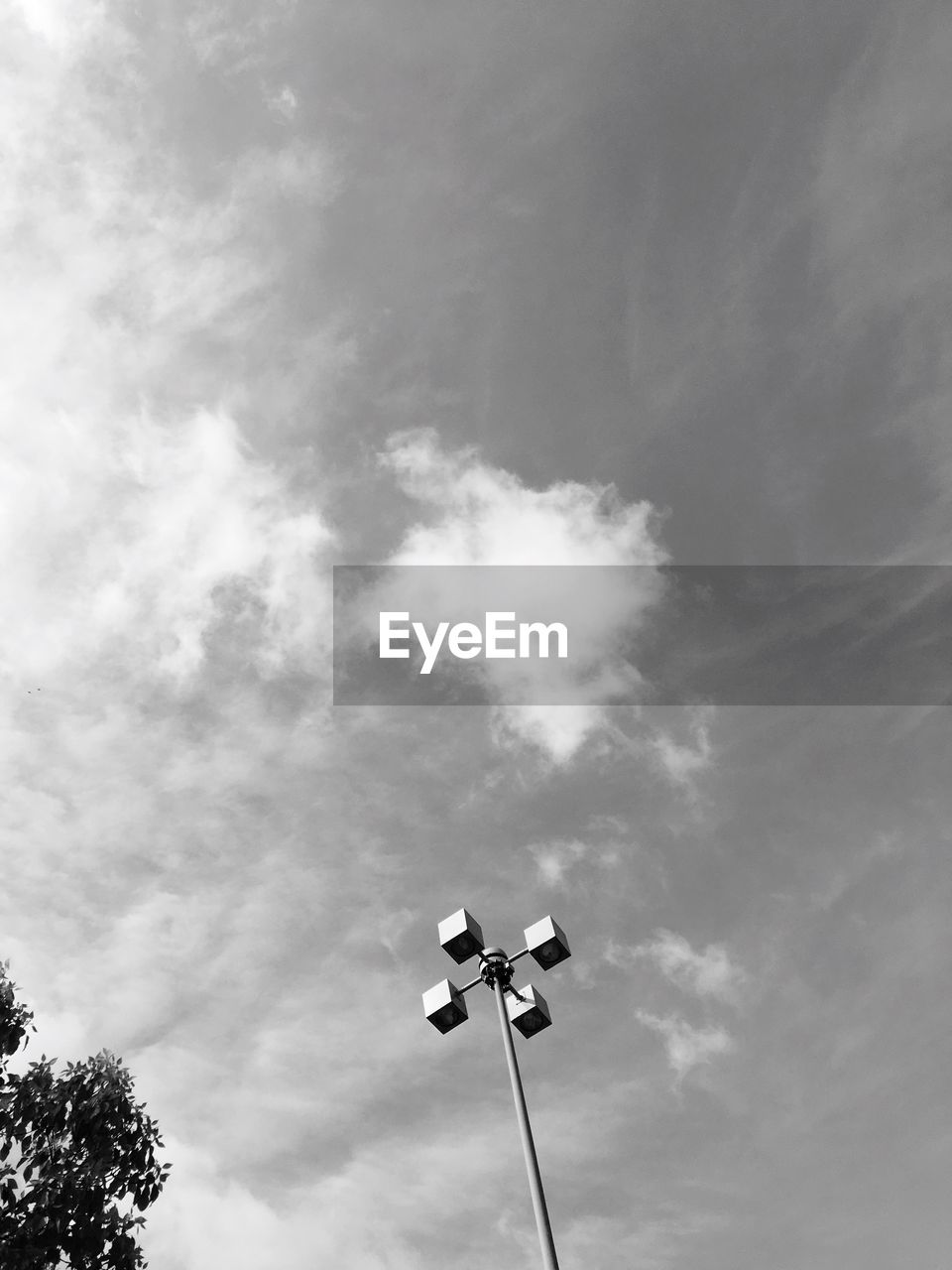low angle view, guidance, communication, cloud - sky, sky, outdoors, day, no people, floodlight, nature, road sign