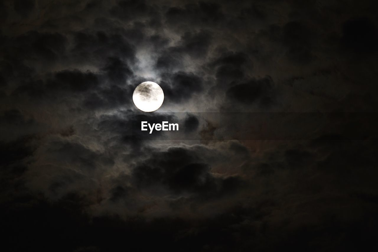 moon, astronomy, beauty in nature, nature, scenics, sky, planetary moon, night, tranquility, tranquil scene, no people, cloud - sky, solar eclipse, moon surface, sky only, outdoors, low angle view, moonlight, space exploration, space