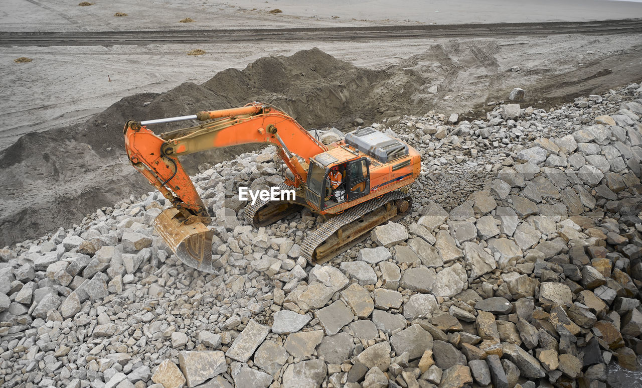 HIGH ANGLE VIEW OF CONSTRUCTION SITE BY STONES