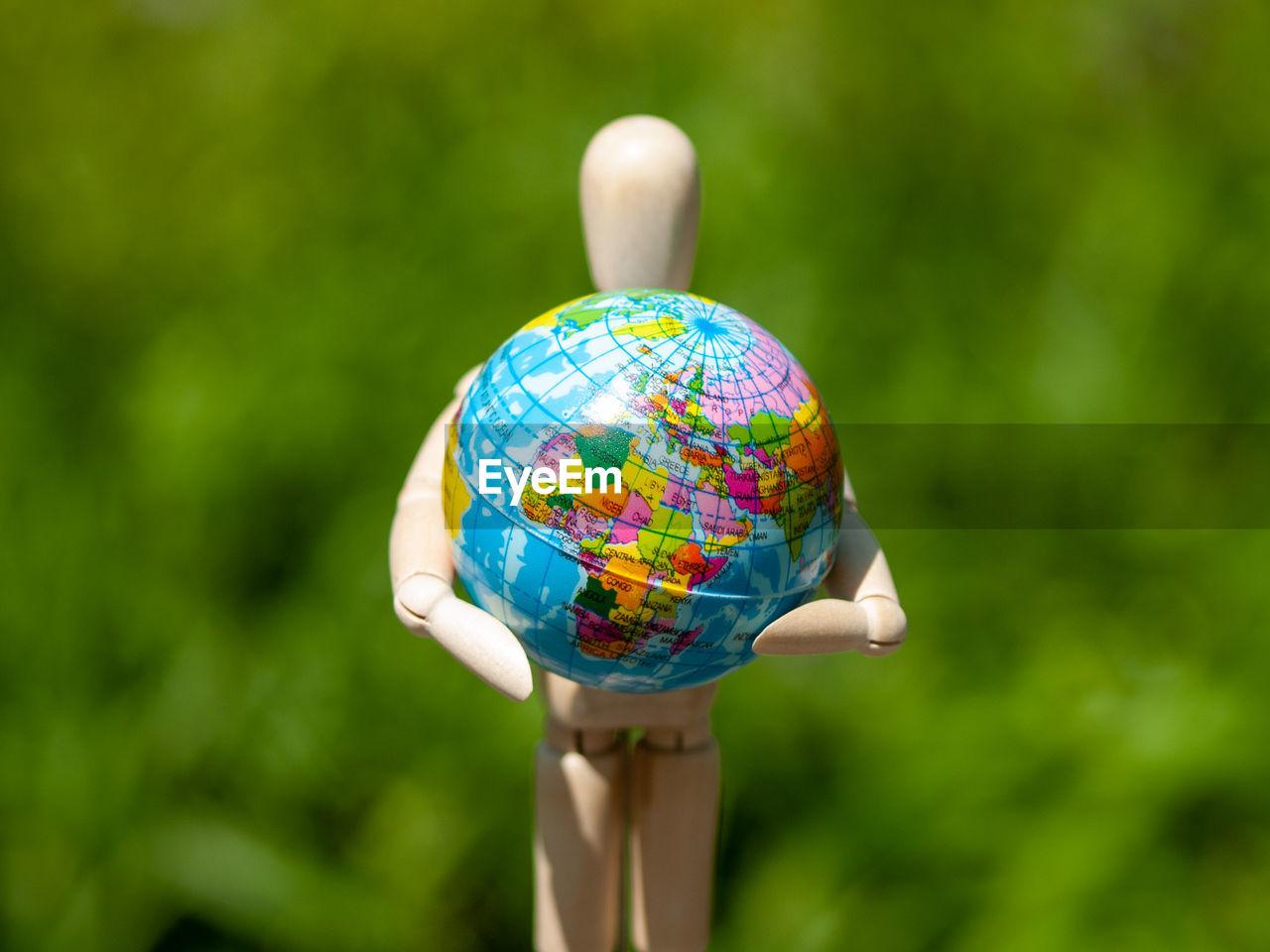 Close-up of figurine with globe
