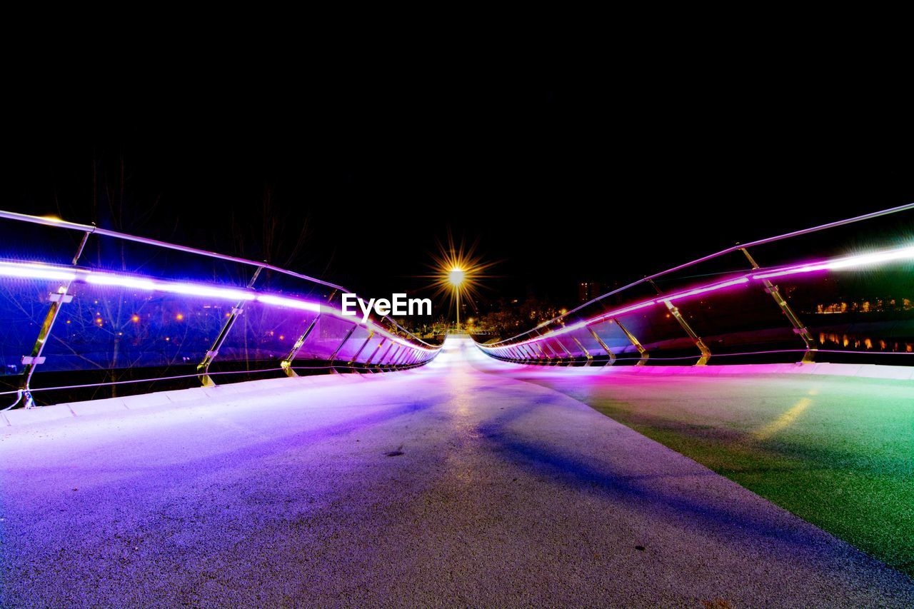 View of illuminated bridge against sky at night