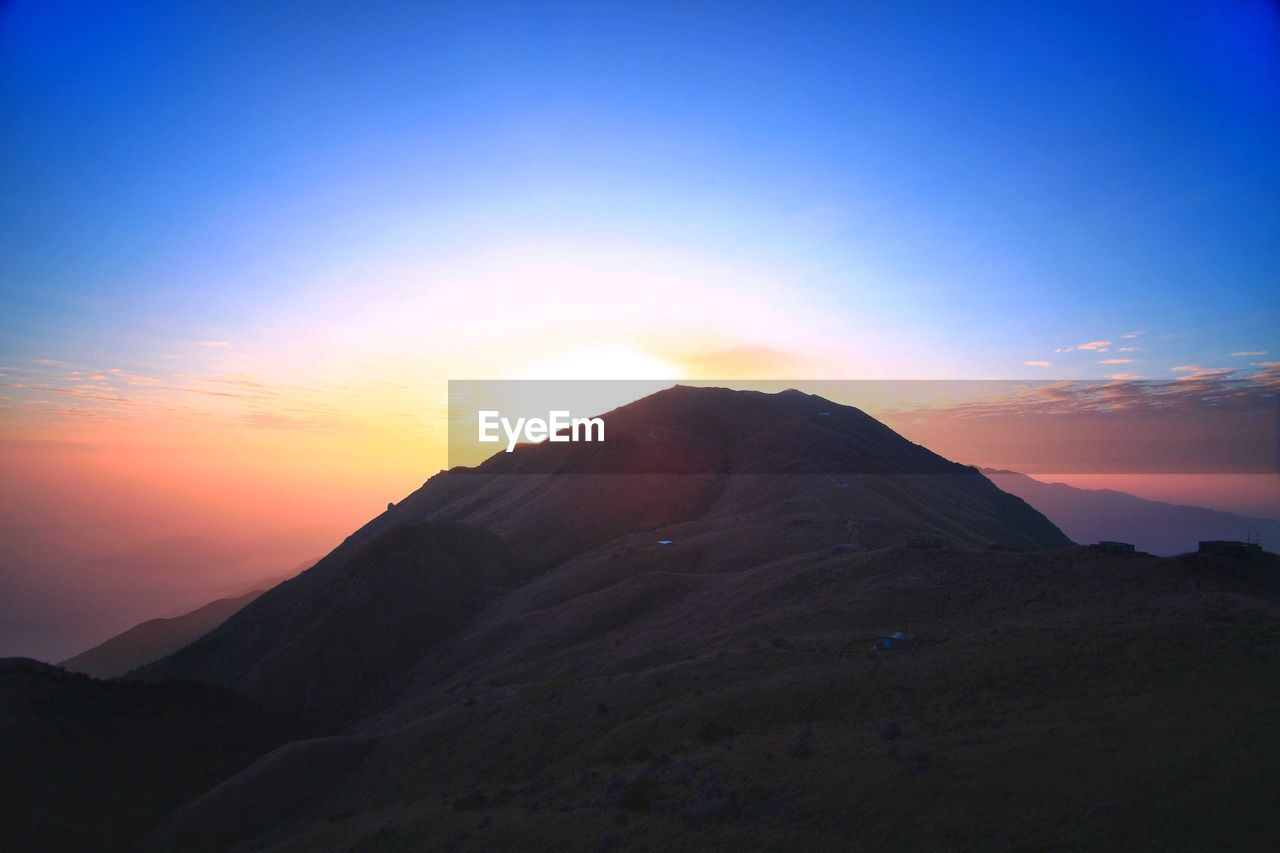sunset, mountain, scenics, nature, tranquil scene, beauty in nature, tranquility, sky, mountain range, landscape, no people, outdoors, travel destinations, day