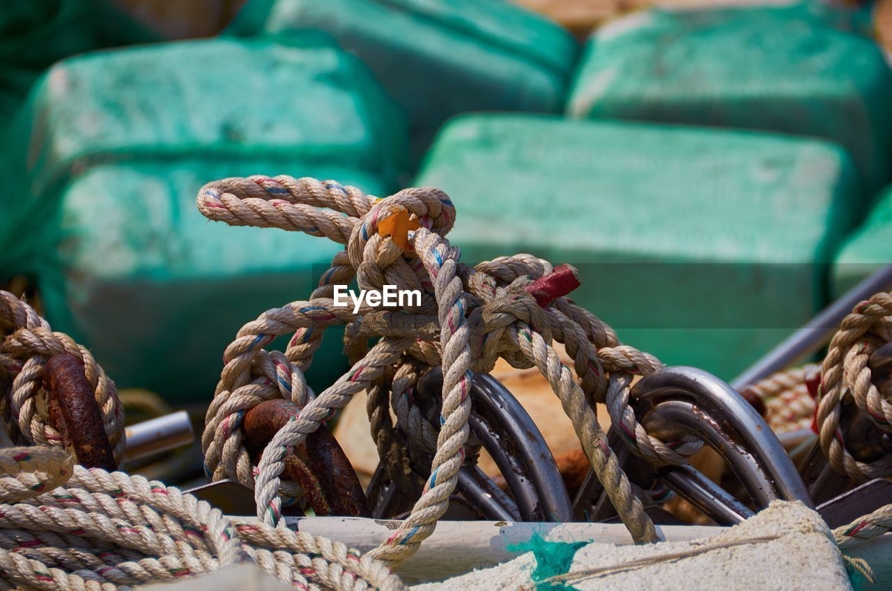 Close-Up Of Tangled Rope At Harbor