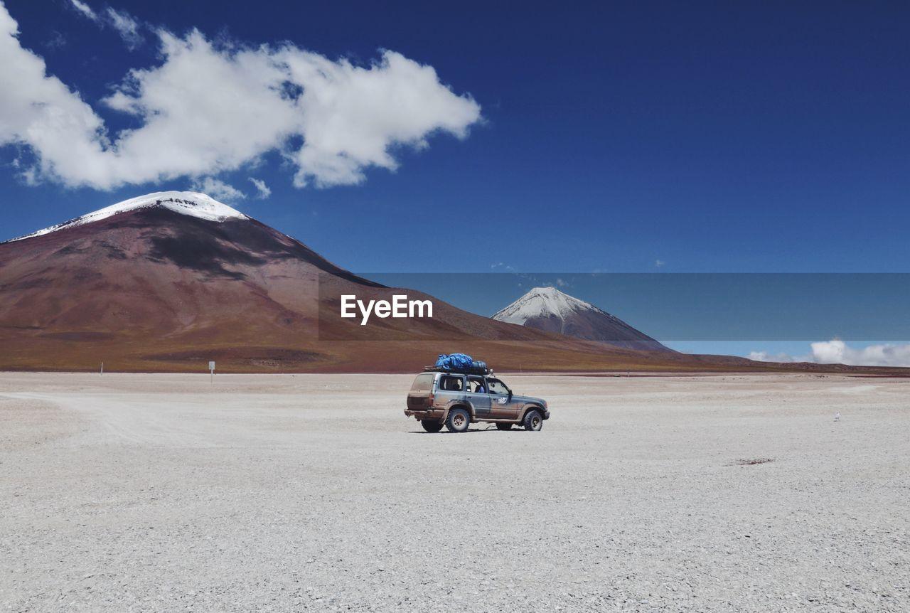 View Of Desert Against Mountain Range
