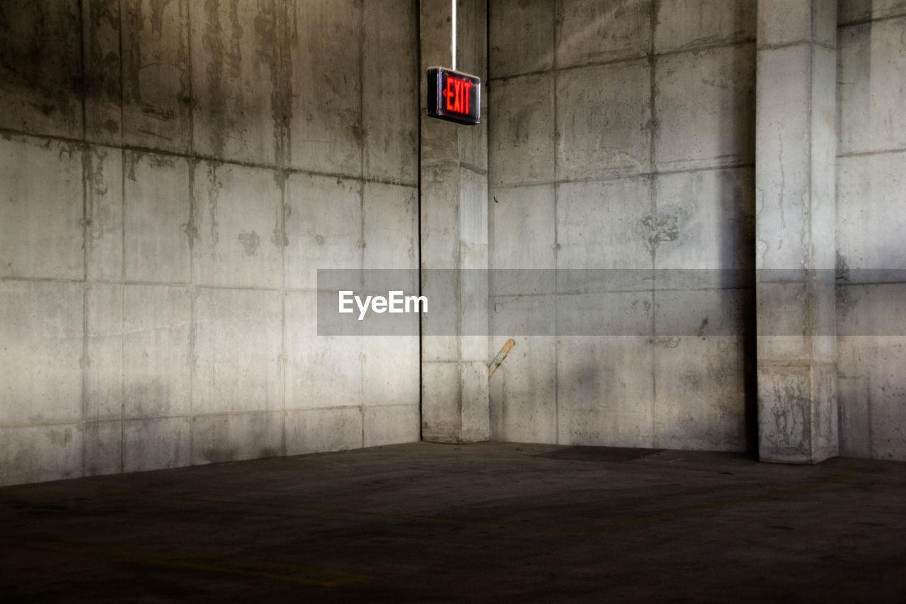 Illuminated Exit Sign On Wall