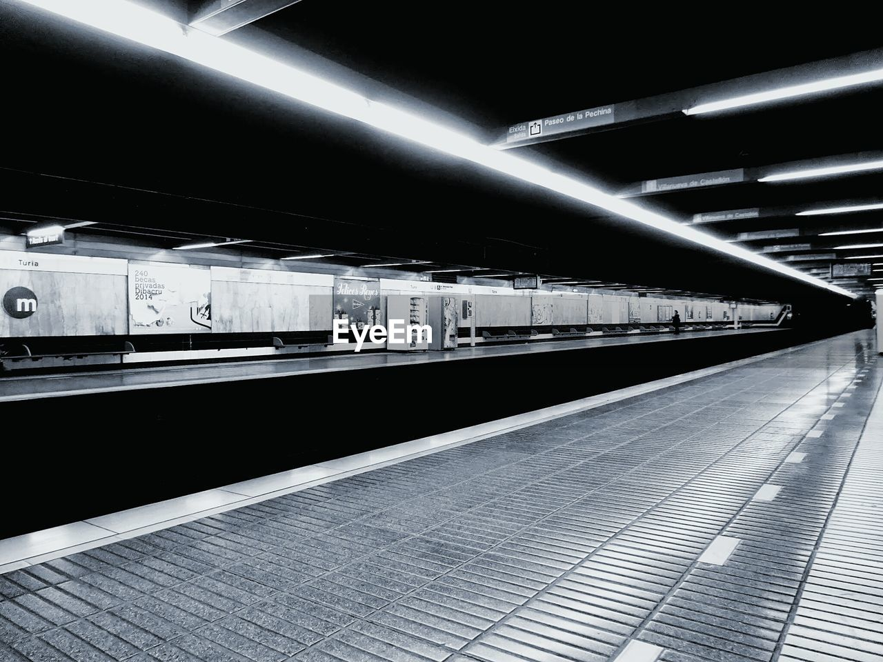 Interior of empty illuminated subway station
