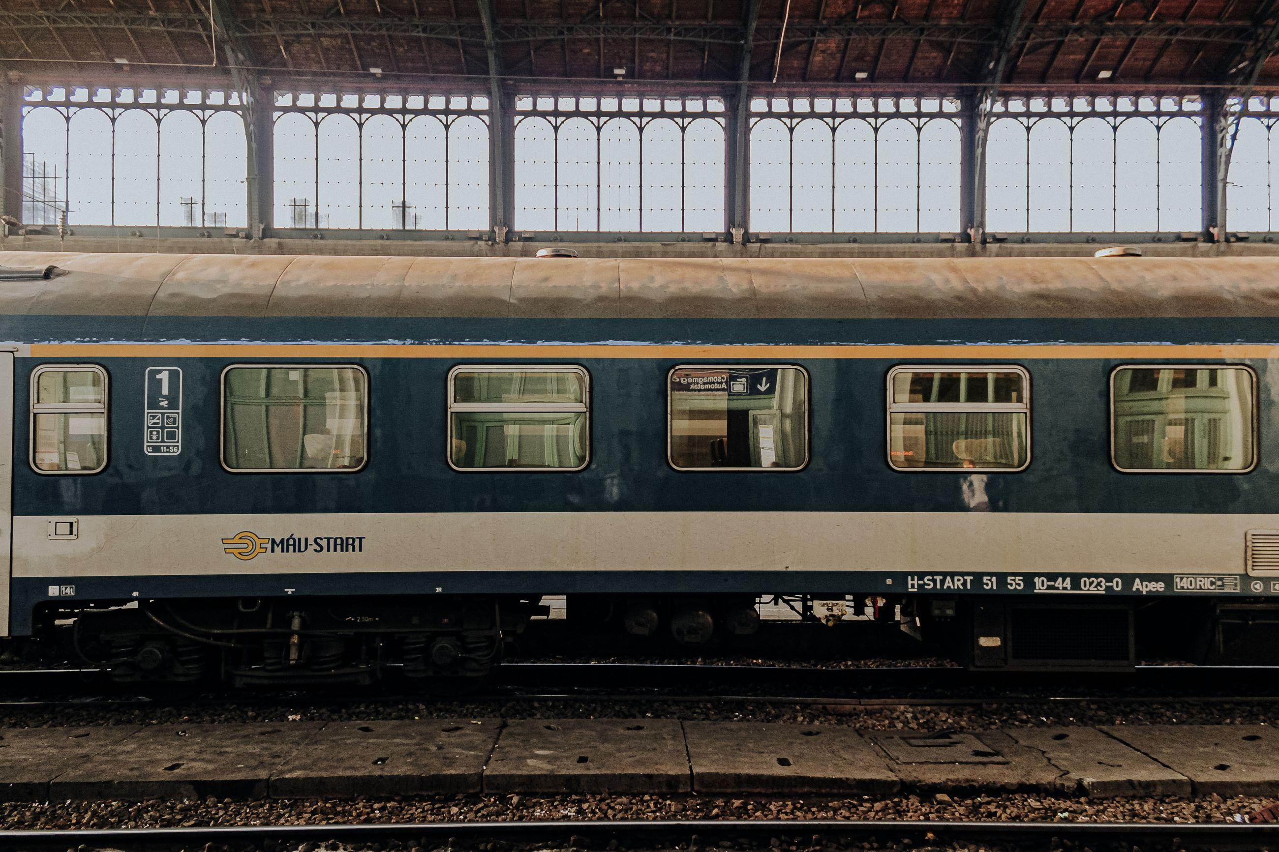 TRAIN IN RAILROAD STATION