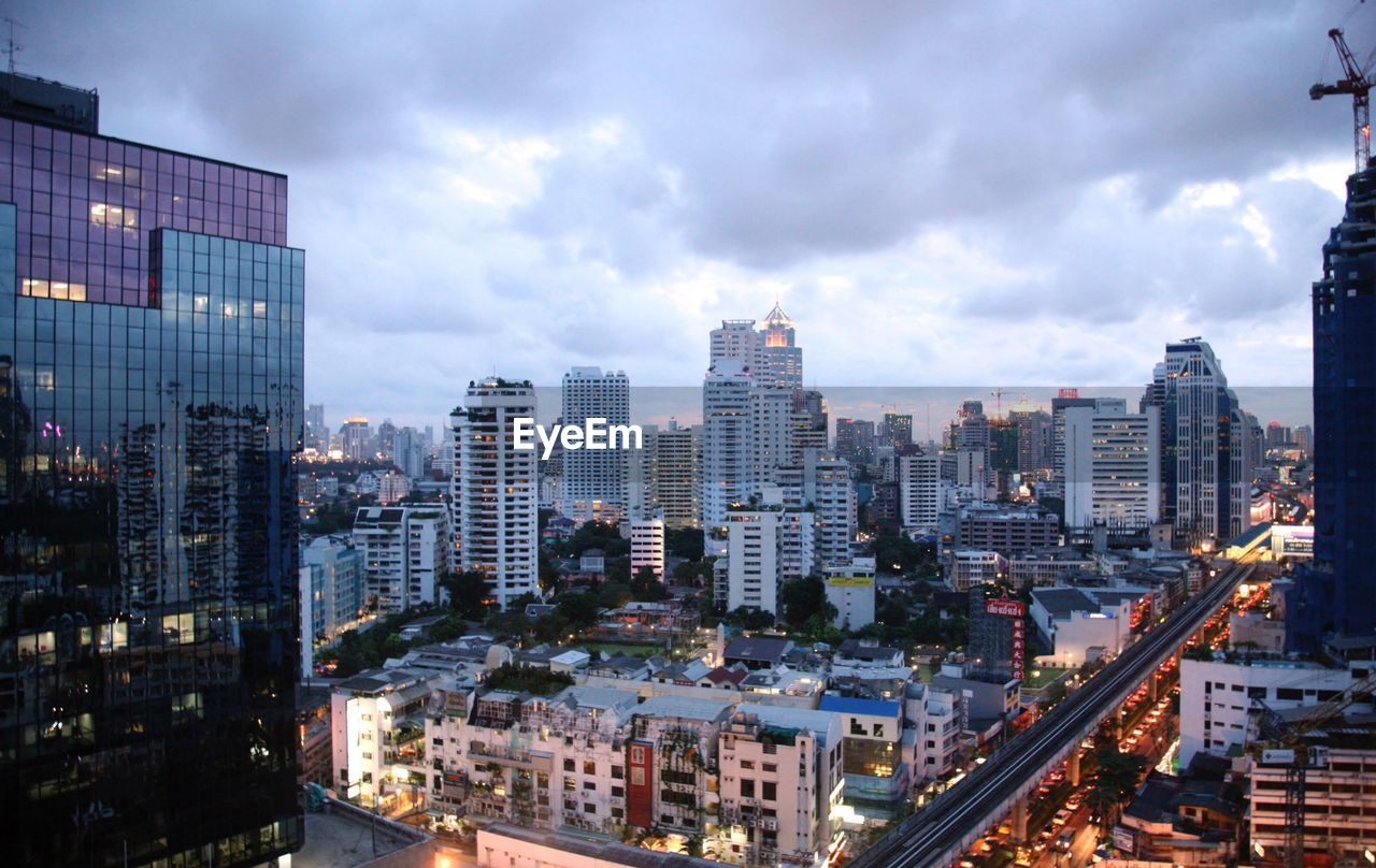 building exterior, architecture, city, built structure, cloud - sky, building, cityscape, sky, office building exterior, no people, modern, nature, residential district, skyscraper, office, high angle view, outdoors, illuminated, financial district