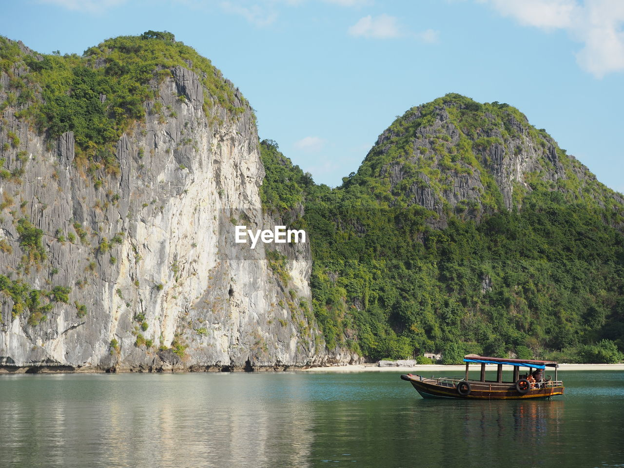 Boat On Halong Bay By Rocky Mountains