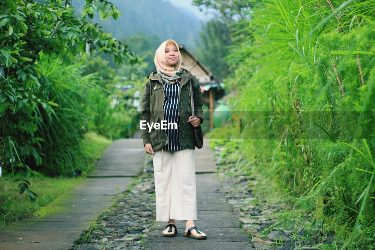 A pregnant woman smile in the park. taken at salatiga january 2020