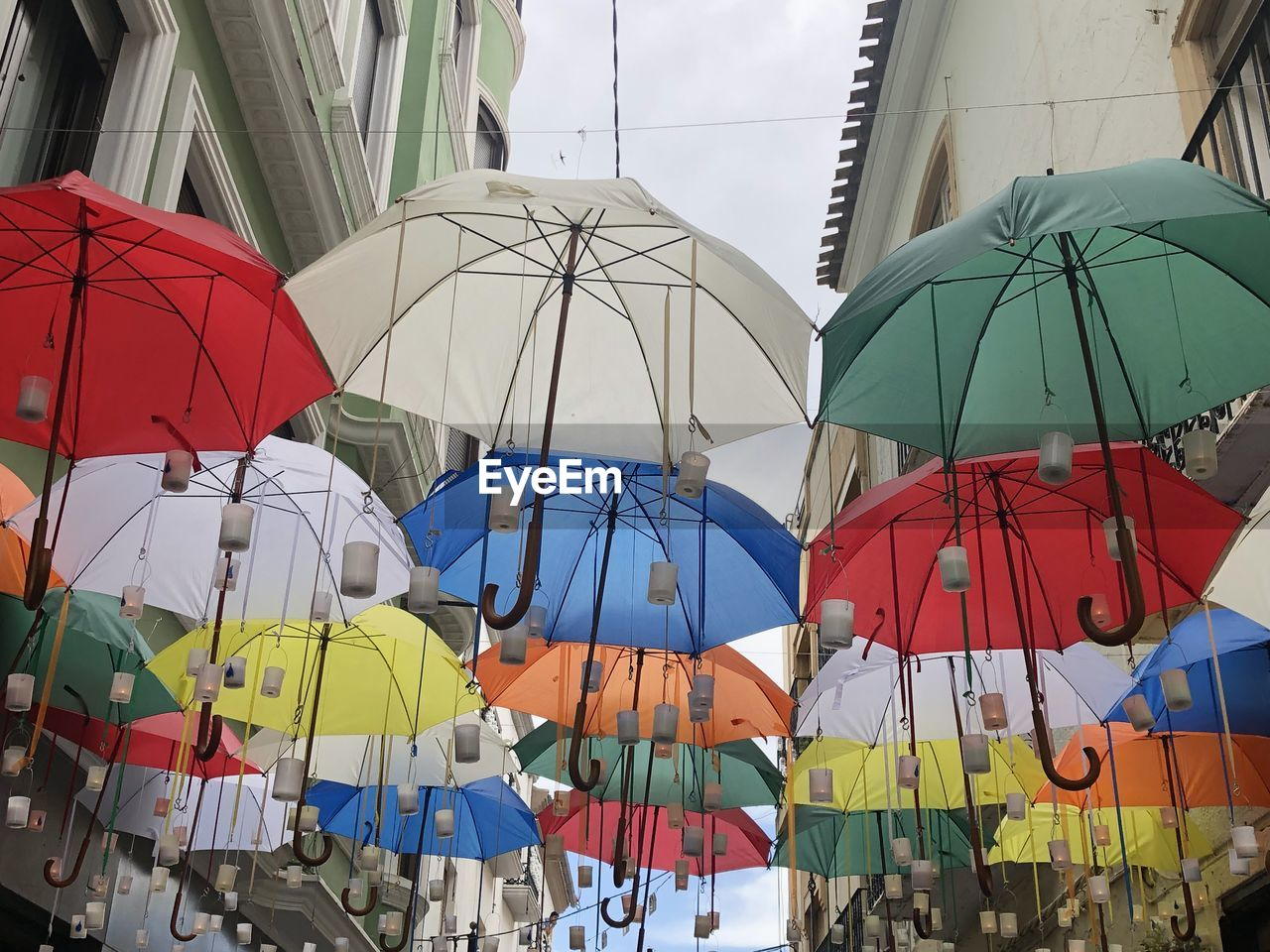 protection, umbrella, multi colored, security, hanging, day, no people, side by side, choice, architecture, outdoors, variation, nature, parasol, low angle view, market, retail, built structure, in a row