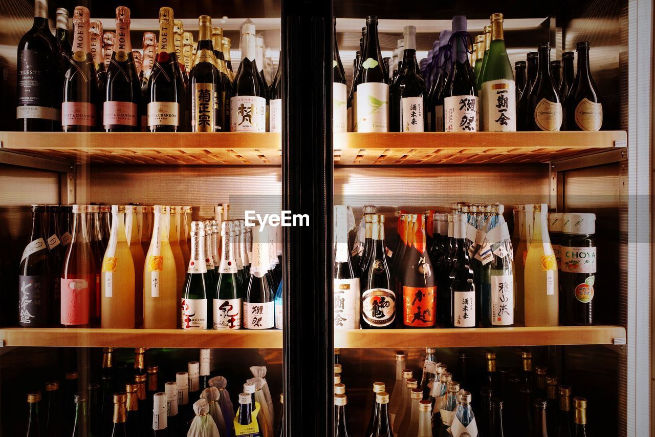 bottle, container, shelf, food and drink, variation, refreshment, alcohol, large group of objects, drink, choice, indoors, no people, arrangement, wine bottle, in a row, abundance, still life, order, collection, retail, sale, red wine, liquor store