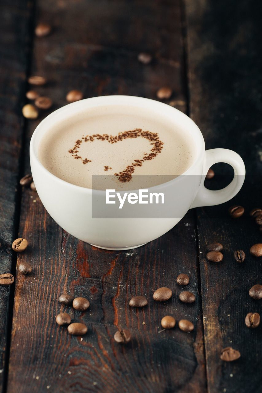 cup, food and drink, drink, mug, refreshment, coffee, coffee cup, coffee - drink, still life, table, frothy drink, wood - material, freshness, hot drink, food, no people, indoors, cappuccino, close-up, white color, crockery, latte, non-alcoholic beverage