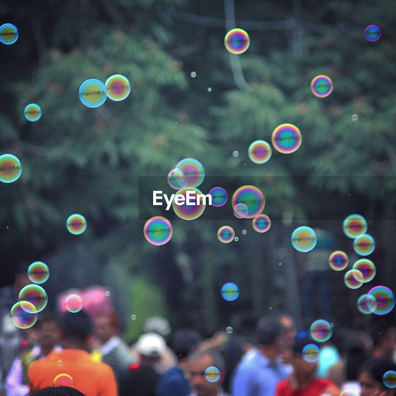 Multi Colored Bubbles In Mid-Air