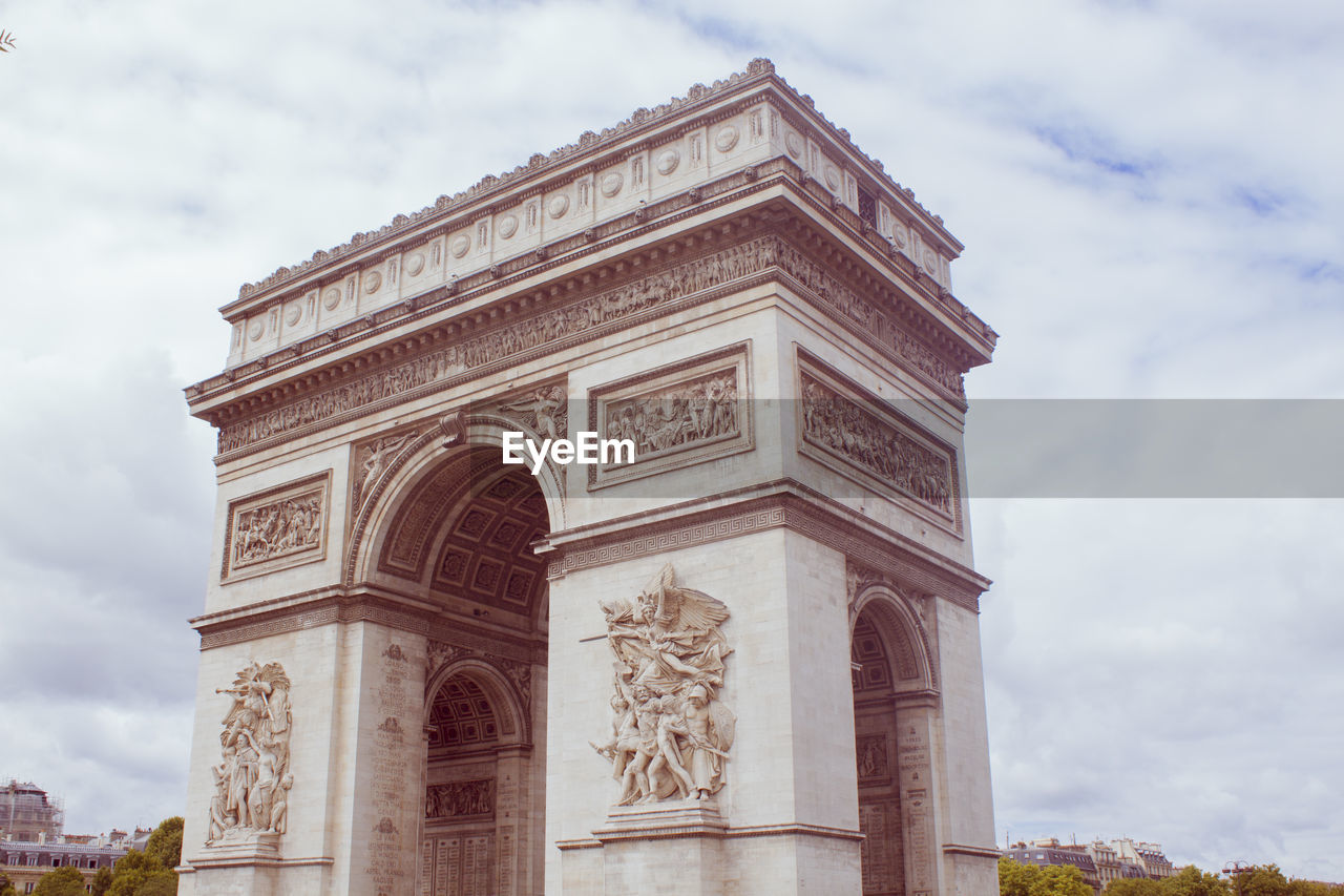 cloud - sky, sky, architecture, built structure, the past, low angle view, history, arch, travel destinations, nature, building exterior, day, no people, city, triumphal arch, monument, tourism, travel, art and craft, ornate, architecture and art