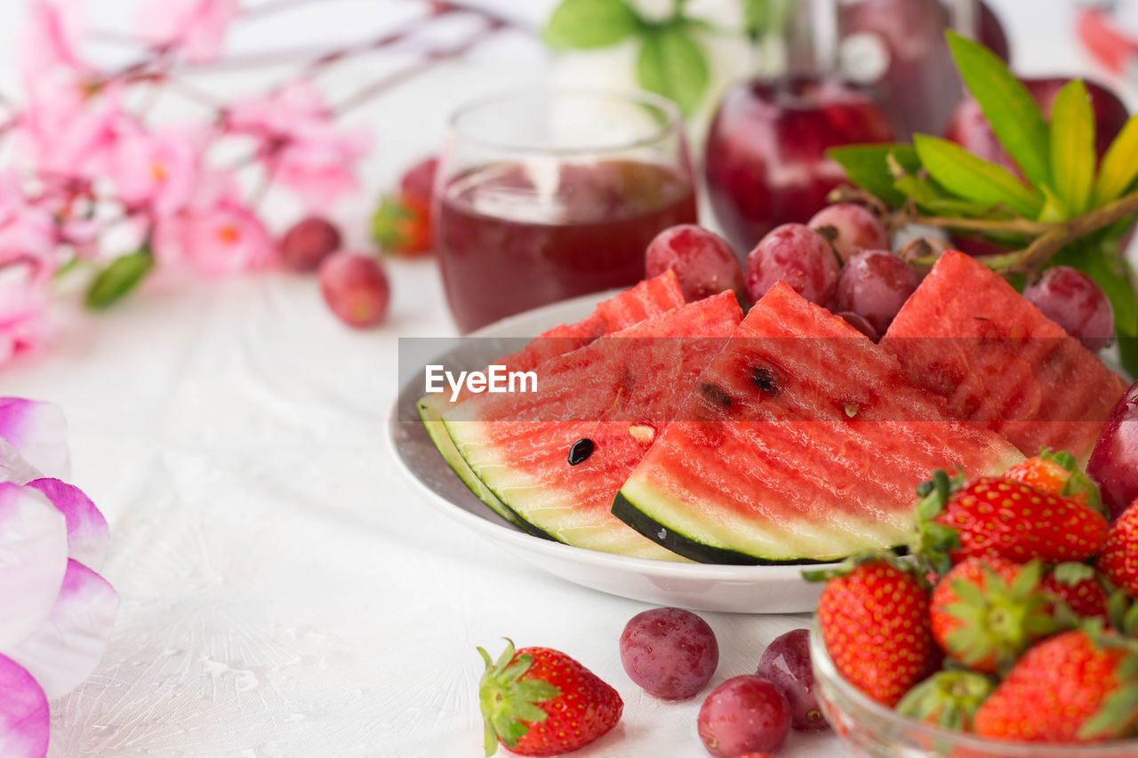freshness, food and drink, food, fruit, healthy eating, wellbeing, table, still life, watermelon, flower, no people, close-up, berry fruit, slice, strawberry, flowering plant, plate, indoors, focus on foreground, red, glass, temptation
