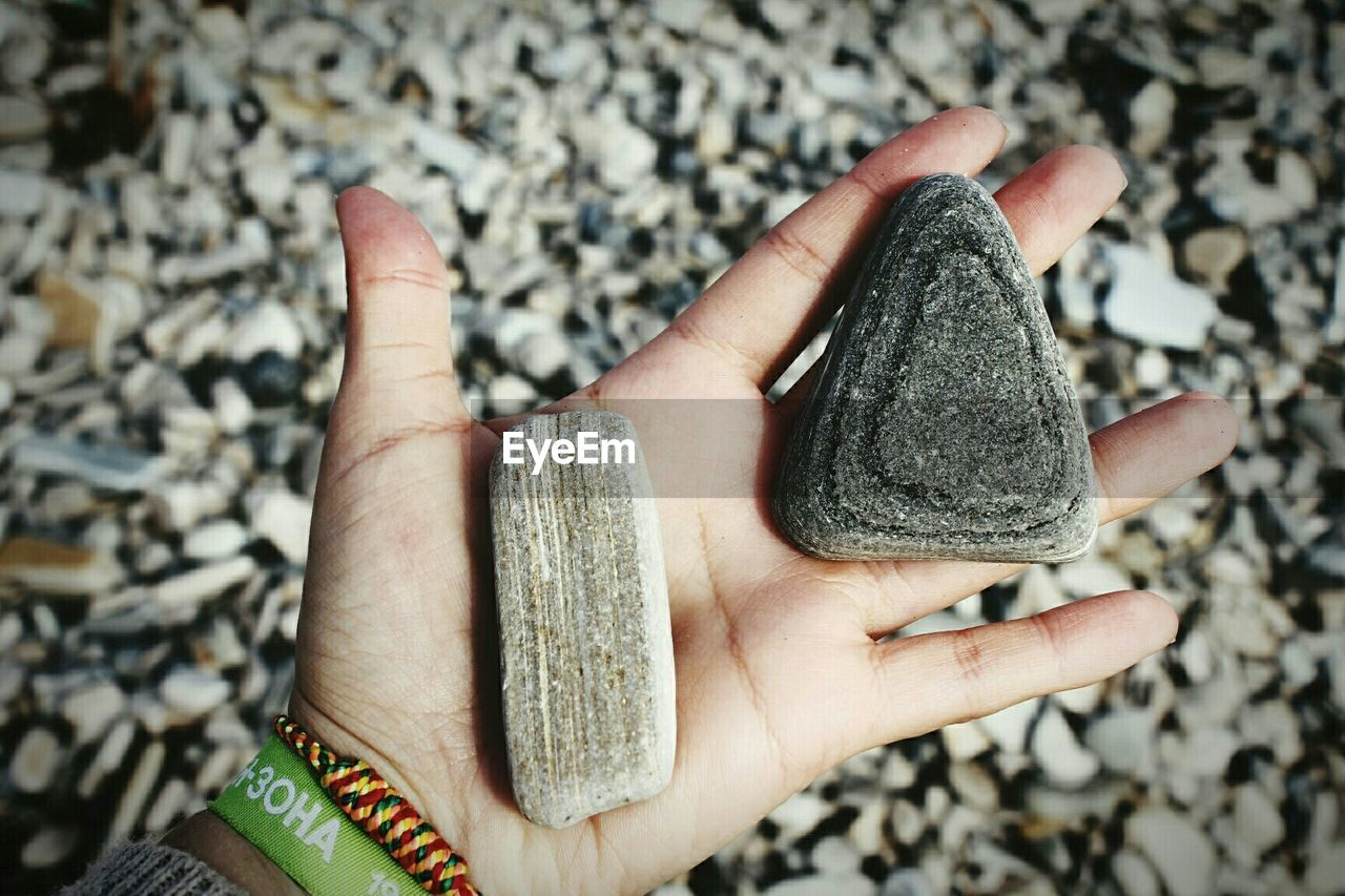 Close-Up Of A Hand Holding Stones