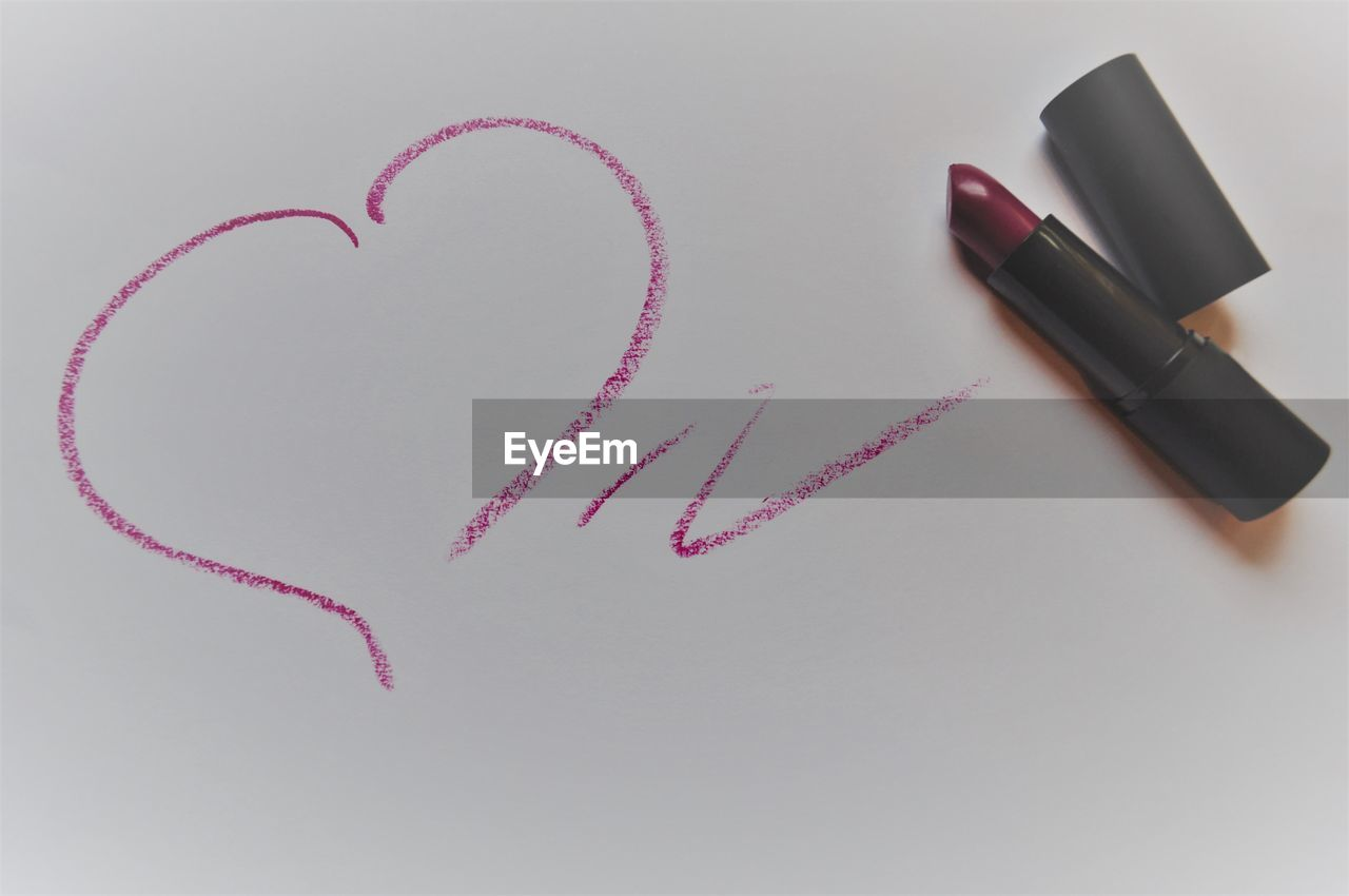 indoors, still life, positive emotion, no people, love, heart shape, high angle view, lipstick, emotion, make-up, white background, close-up, paper, pen, writing instrument, studio shot, red, creativity, art and craft, copy space