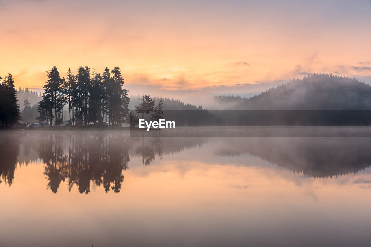 sky, sunset, beauty in nature, tranquility, water, tranquil scene, scenics - nature, reflection, lake, tree, orange color, idyllic, plant, cloud - sky, waterfront, non-urban scene, no people, nature, fog, outdoors, reflection lake