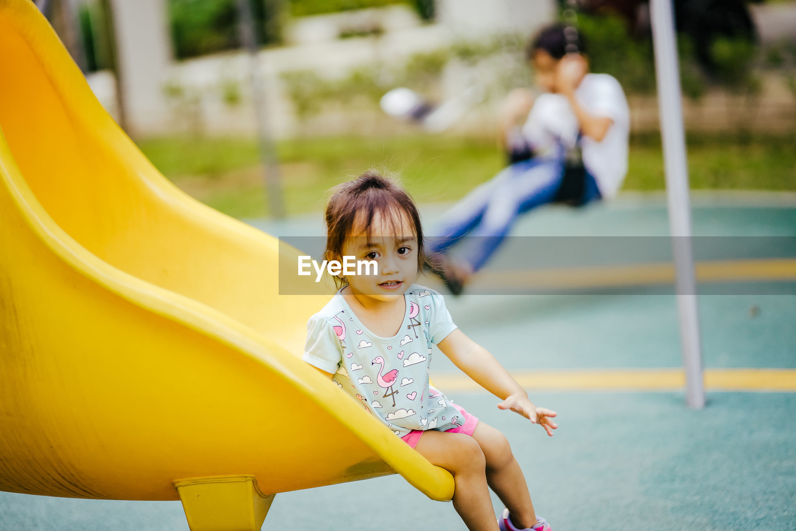Portrait of girl playing on slide