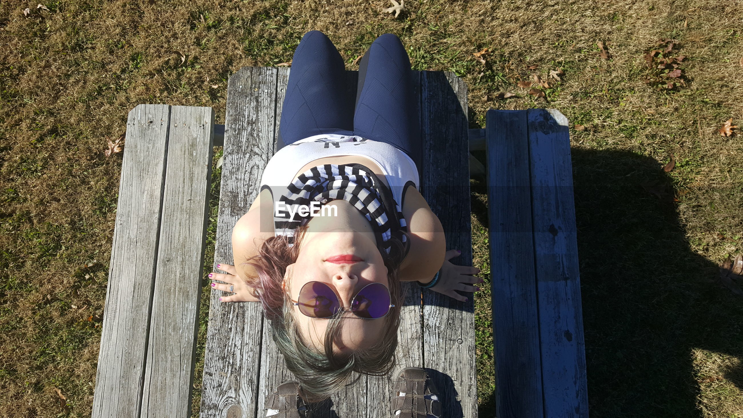High angle view of girl on bench over field