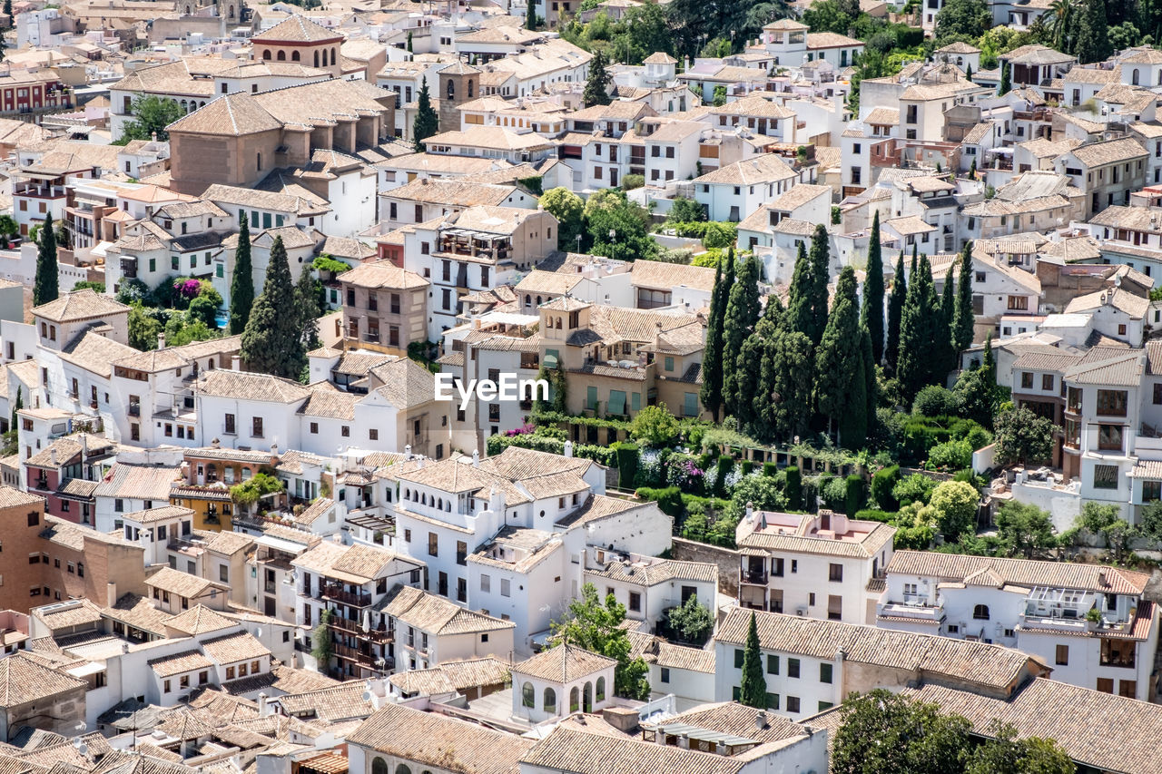 building exterior, architecture, built structure, city, residential district, building, tree, crowded, high angle view, nature, plant, town, community, day, house, outdoors, cityscape, travel destinations, townscape, apartment