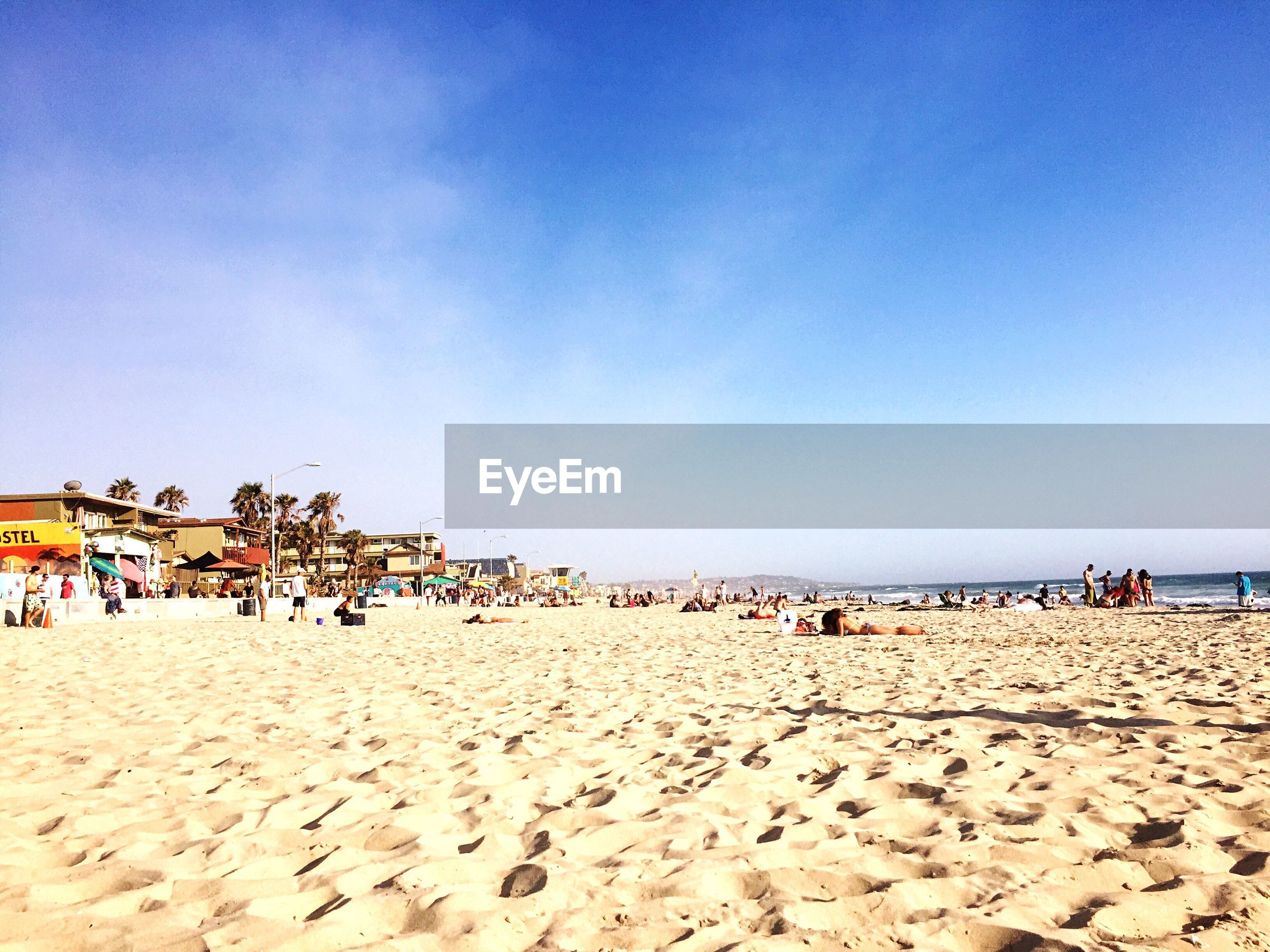 beach, sand, sea, shore, clear sky, copy space, vacations, large group of people, beach umbrella, blue, tranquility, horizon over water, tranquil scene, scenics, sky, beauty in nature, water, nature, summer