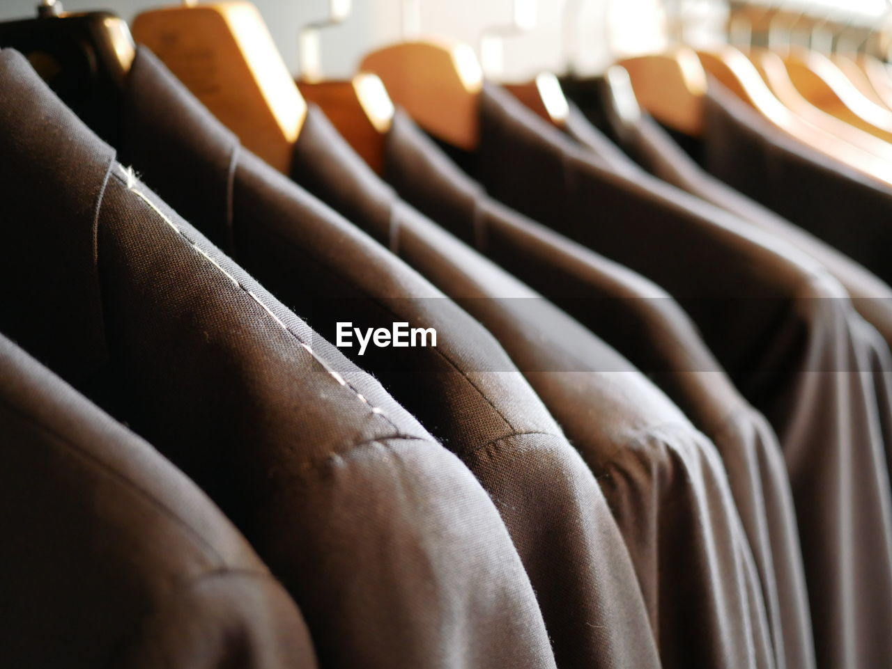 Close-Up Of Clothes Hanging In Row
