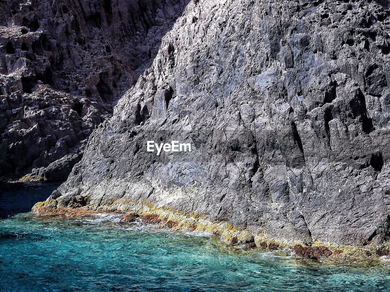 nature, rock formation, no people, rock - object, beauty in nature, waterfront, water, tranquility, day, scenics, outdoors, sea