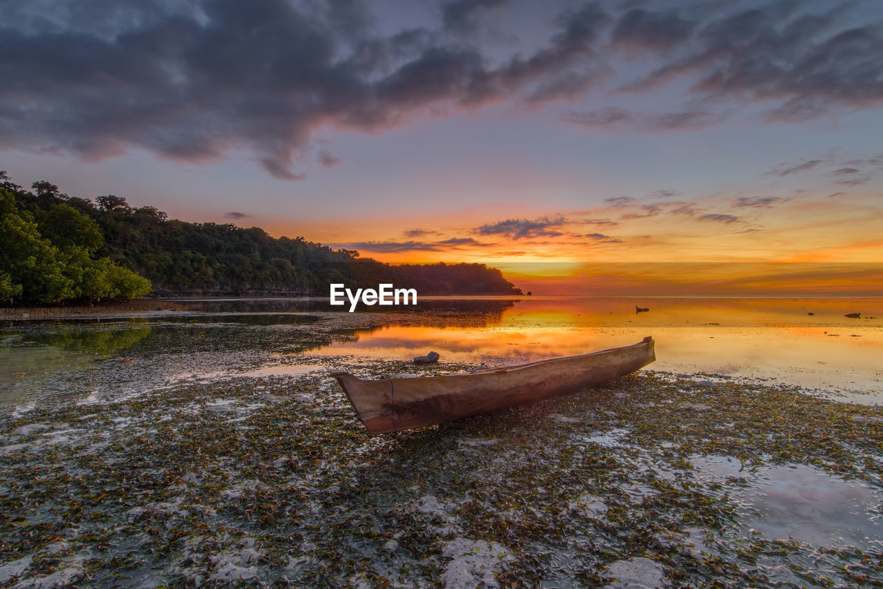 water, sky, sunset, nautical vessel, cloud - sky, scenics - nature, beauty in nature, tranquility, tranquil scene, transportation, mode of transportation, nature, beach, land, sea, moored, idyllic, reflection, no people, outdoors, rowboat