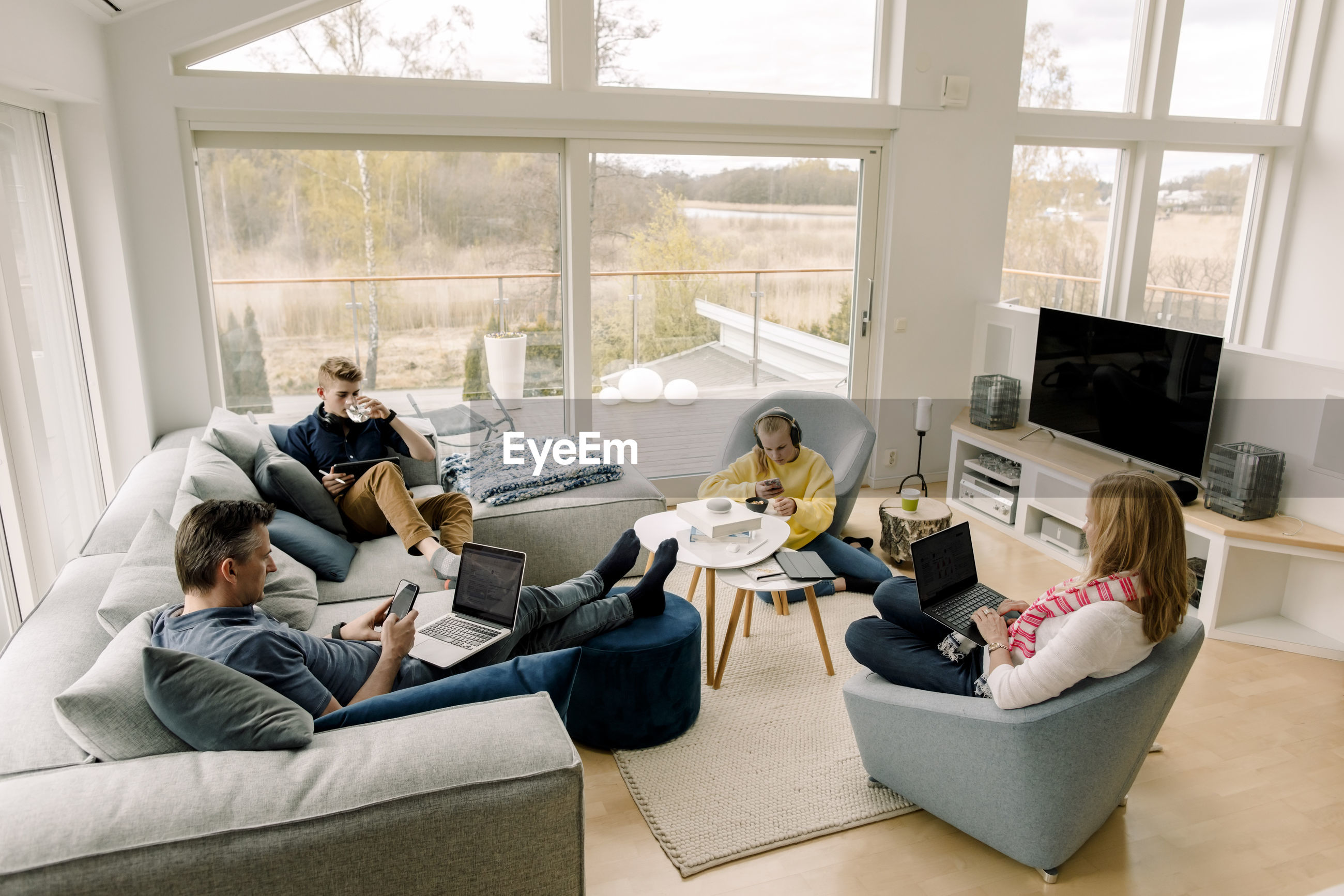 GROUP OF PEOPLE SITTING ON SOFA