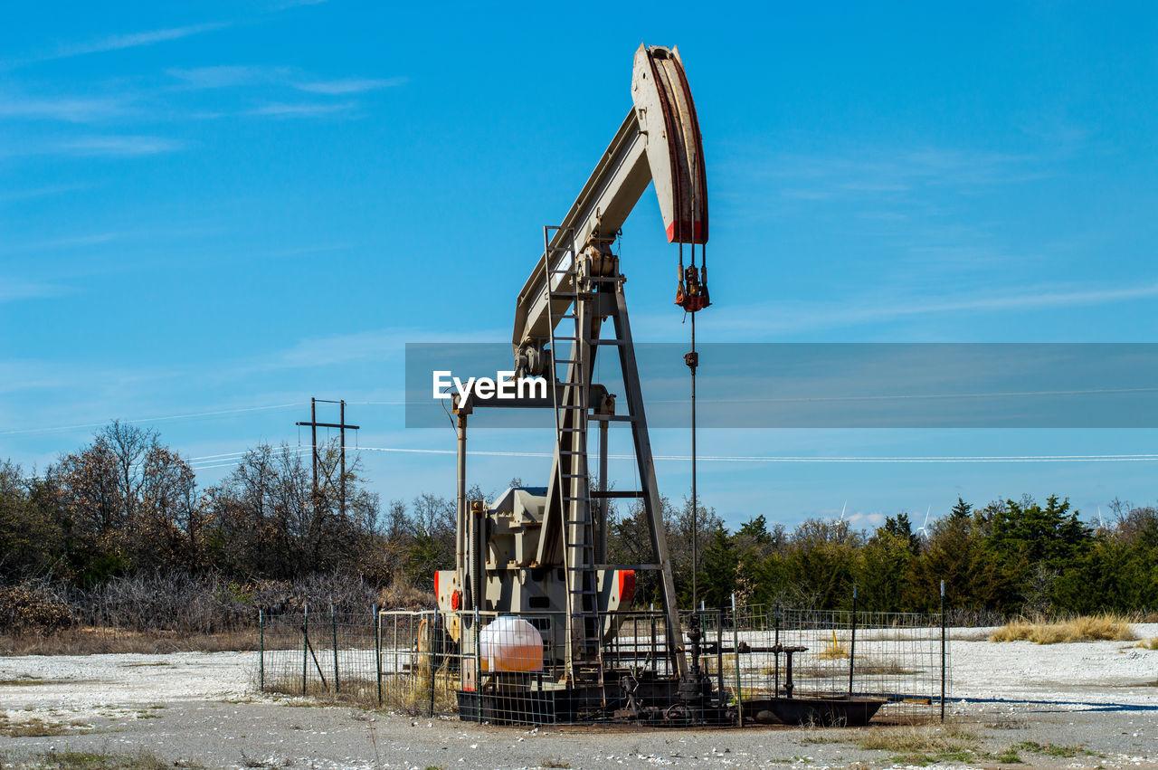 Oil Rig  Against Sky