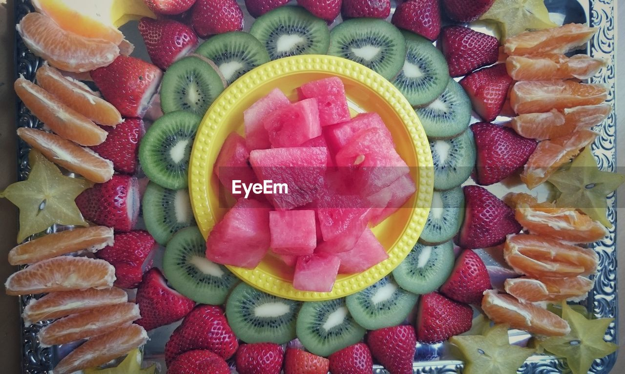 fruit, food and drink, strawberry, food, freshness, kiwi - fruit, slice, healthy eating, dessert, banana, sweet food, variation, no people, indulgence, indoors, watermelon, temptation, close-up, ready-to-eat, multi colored, tart - dessert, day