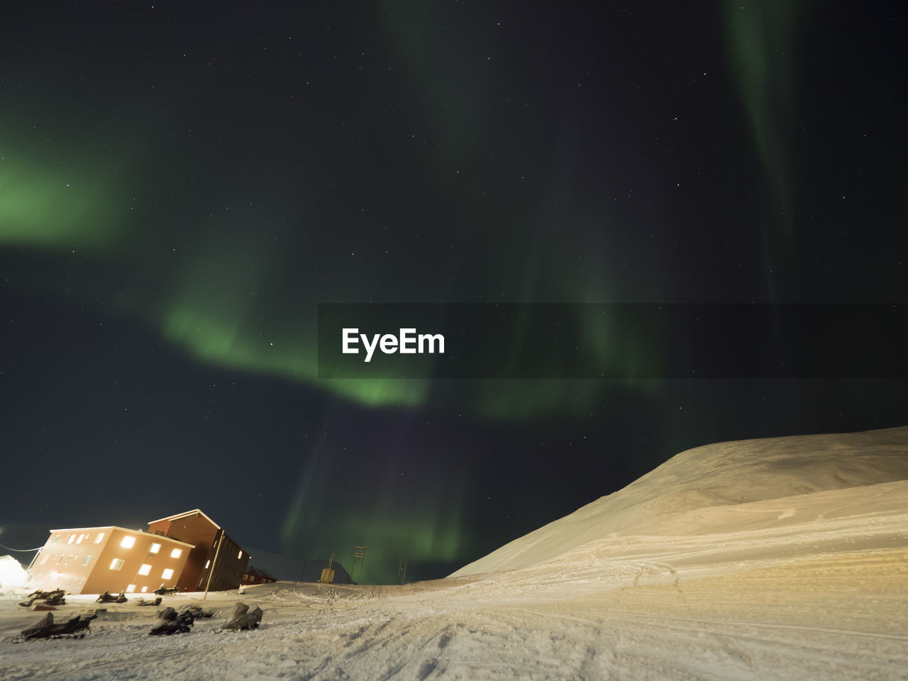 Scenic View Of Illuminated Landscape Against Sky At Night