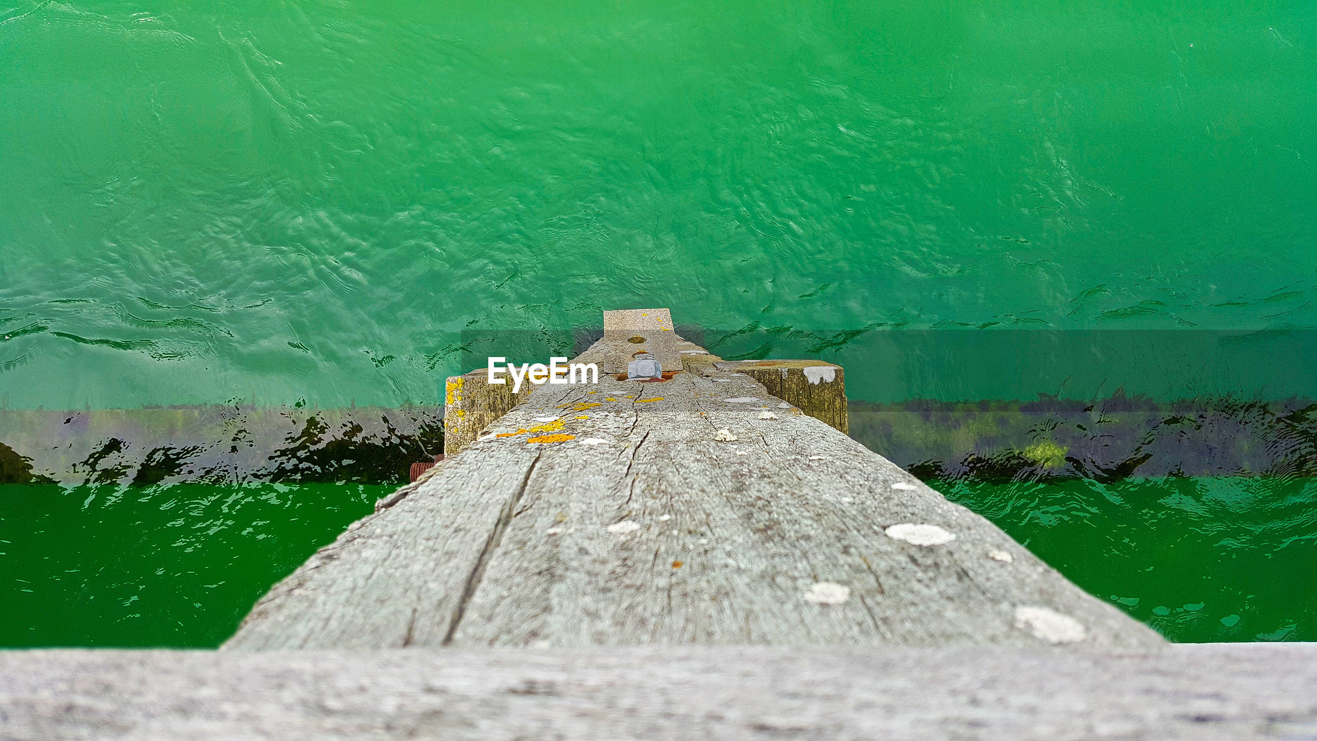 Long wooden jetty leading to sea