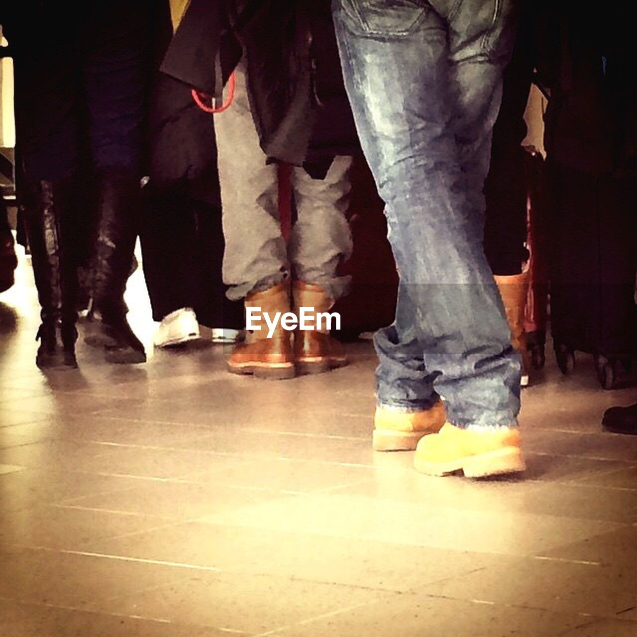 low section, human leg, real people, standing, togetherness, men, indoors, women, medium group of people, leisure activity, human body part, lifestyles, day, bonding, close-up, adult, people, adults only